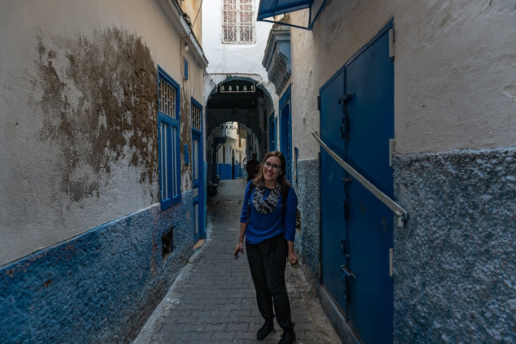 smiling on colorful street in tangier on a day trip to Morocco tour