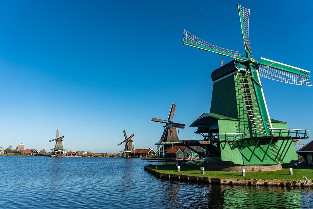 green windmills in zaanse schans on day trip from amsterdam