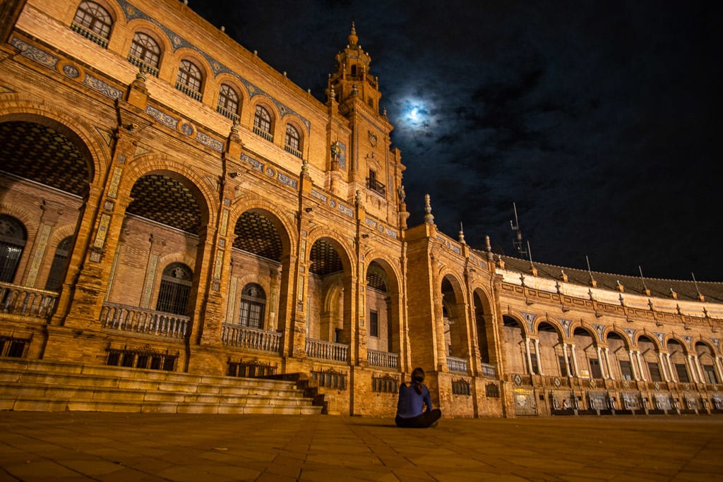 looking up at moon at the plaza de espana in seville at night