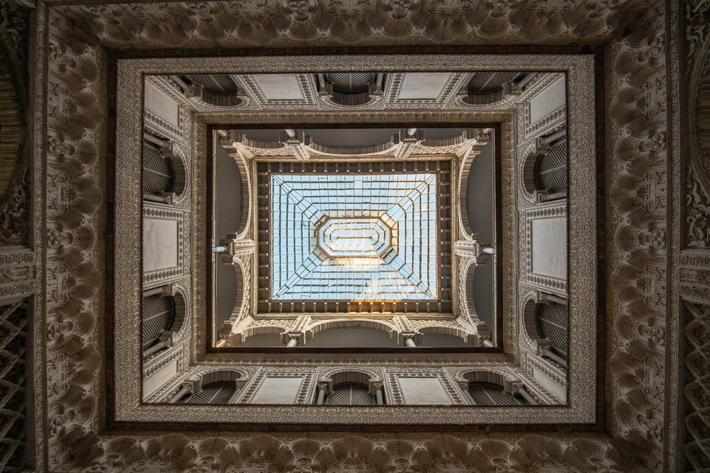 ornate ceiling and upper levels in the real alcazar in sevilla spain