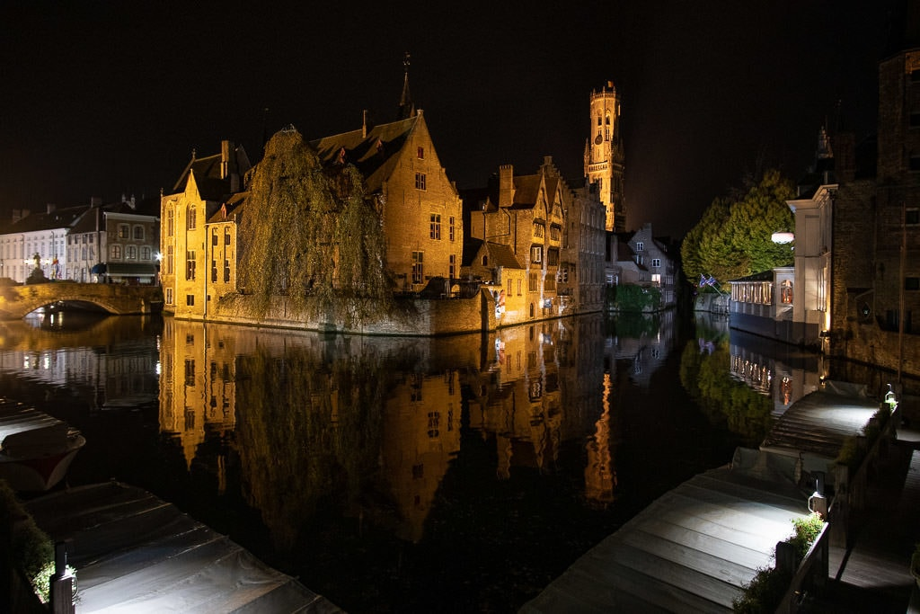 iconic buildings on canal in bruges belgium at night