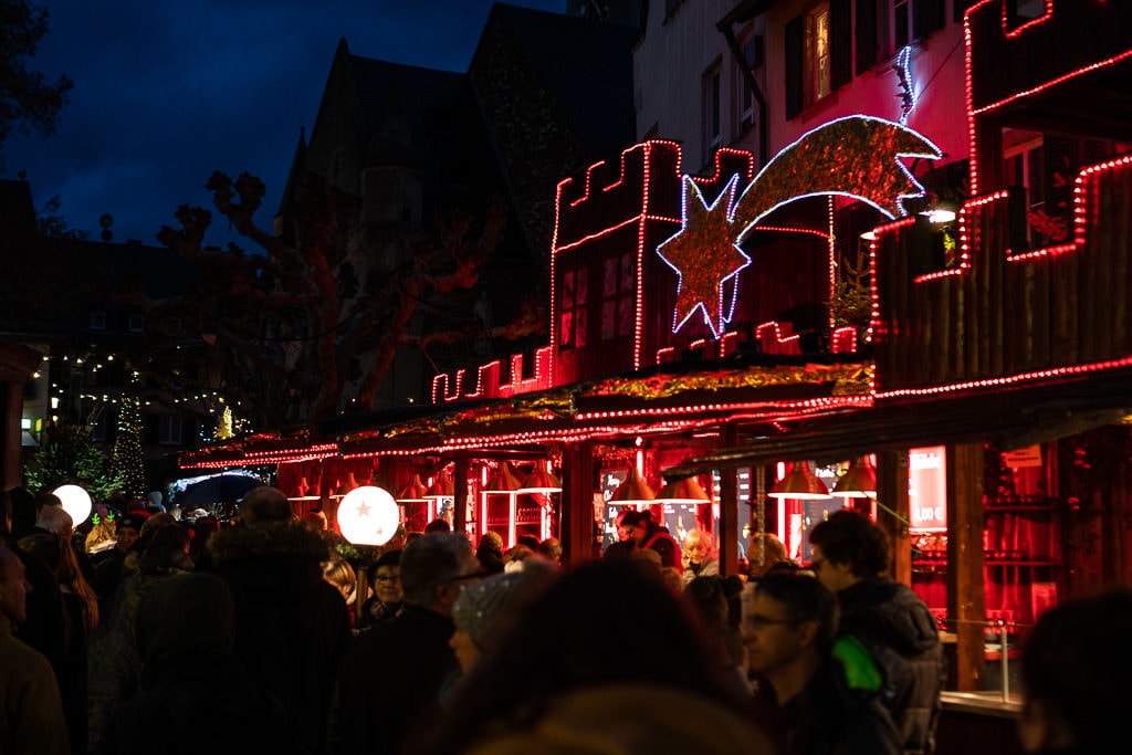 lighted street at rhine river christmas market in germany