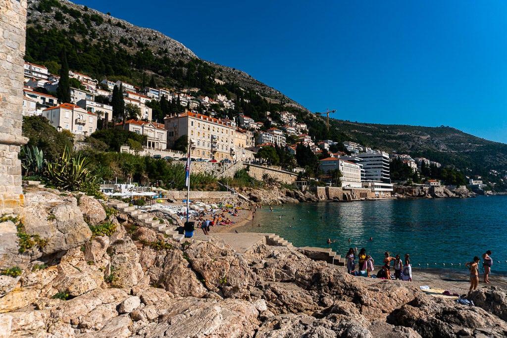 Tourists sunbathing and swimming at Banje Beach