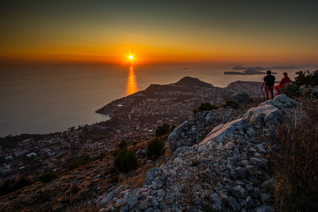 people watching the sunset over Dubrovnik on Mount Srd