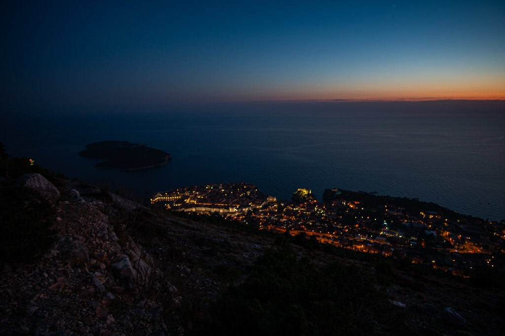 Old Town Dubrovnik city lights on the way down the Mount Srd Trail after sunset
