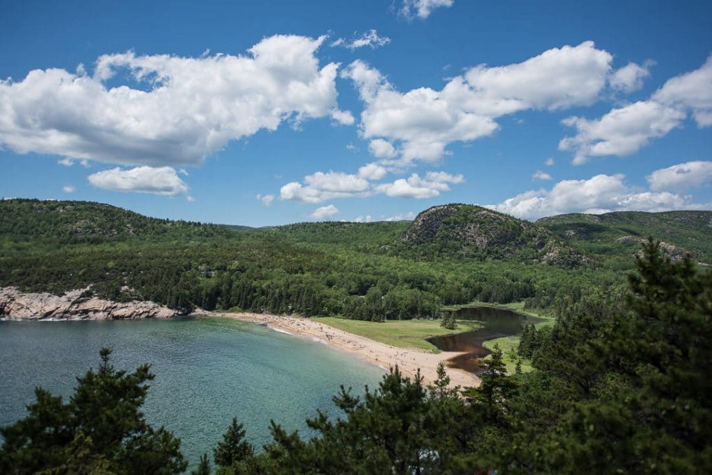 View of Sand Beach from a viewpoint on the Great Head Trail, once of the many hikes in Acadia