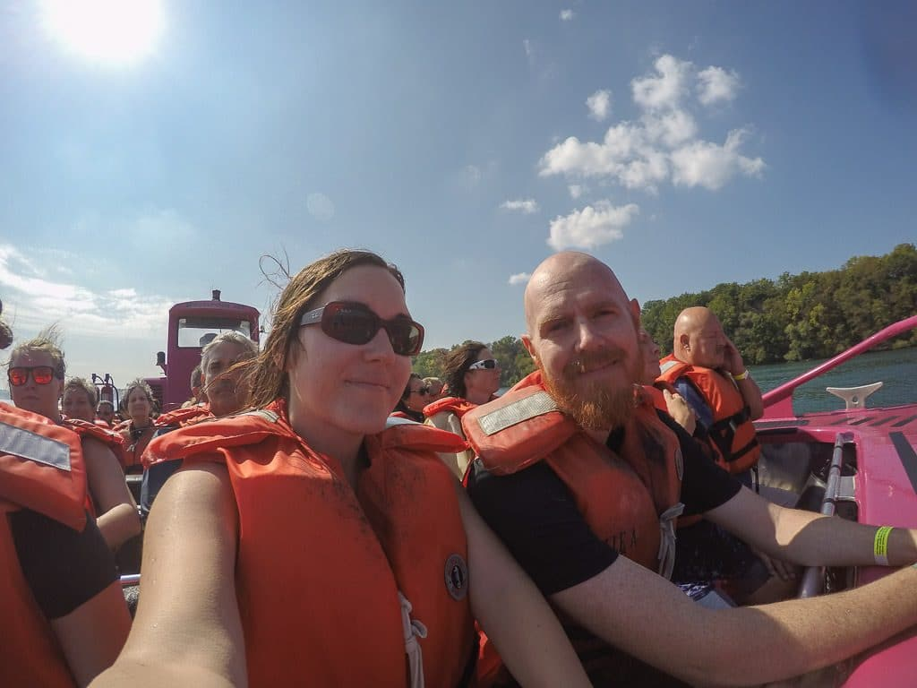 Brooke and Buddy (without his glasses) posing for a photo on the Whirlpool Jet Boat after the tour