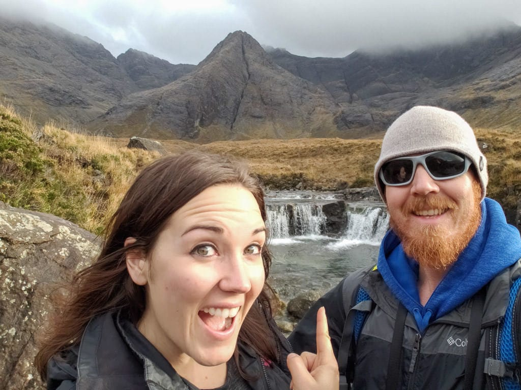 Brooke and Buddy at one of the small waterfalls in the Fairy Pools area of the Isle of Skye, once of the many things to do in the Isle of Skye in Scotland