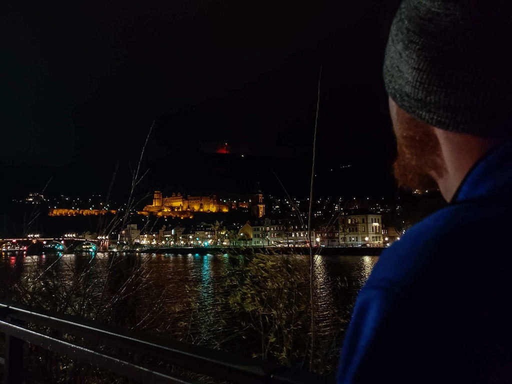 looking at night views of heidelberg castle germany from river