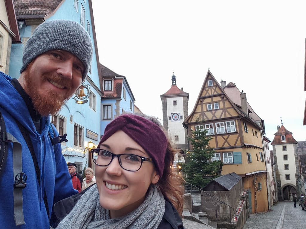 selfie in front of iconic medieval building in rothenburg germany