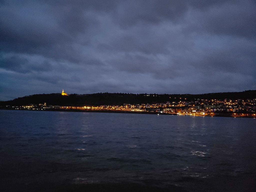 rhine river town lit up at night