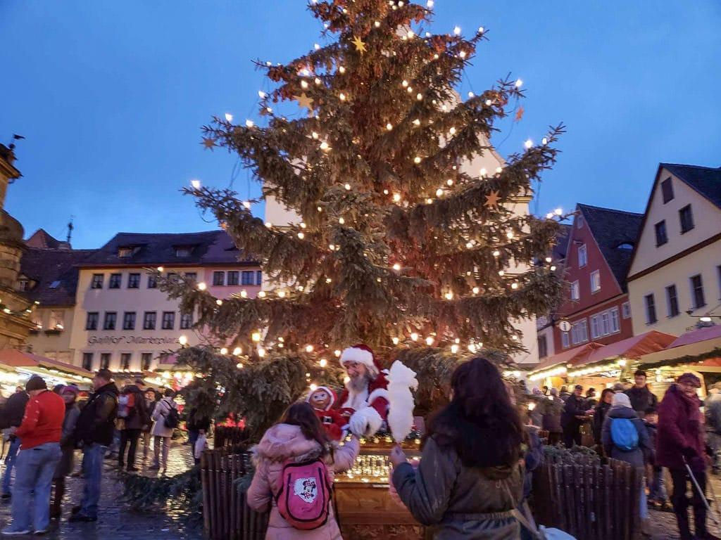 christmas tree and santa at rothenburg christmas markets in germany