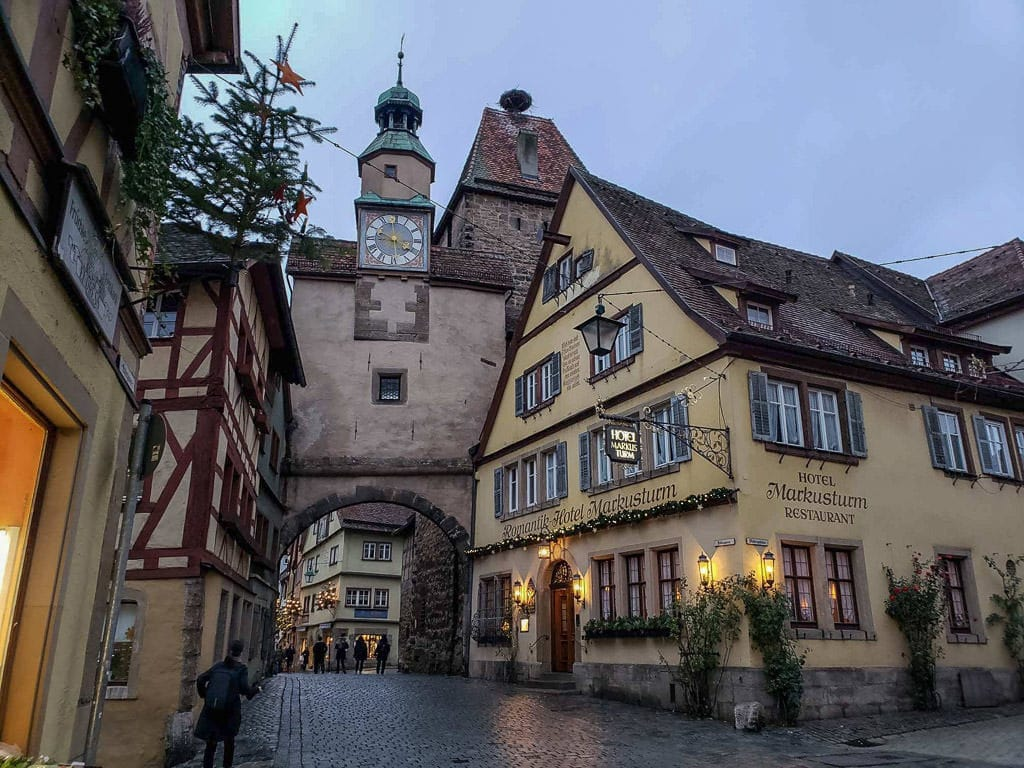 medieval clock tower and buildings in rothenburg in germany