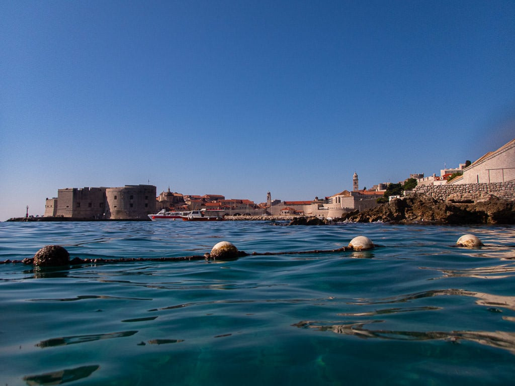 View of Dubrovnik Old Town port from Banje Beach, one of the best beaches in Dubrovnik
