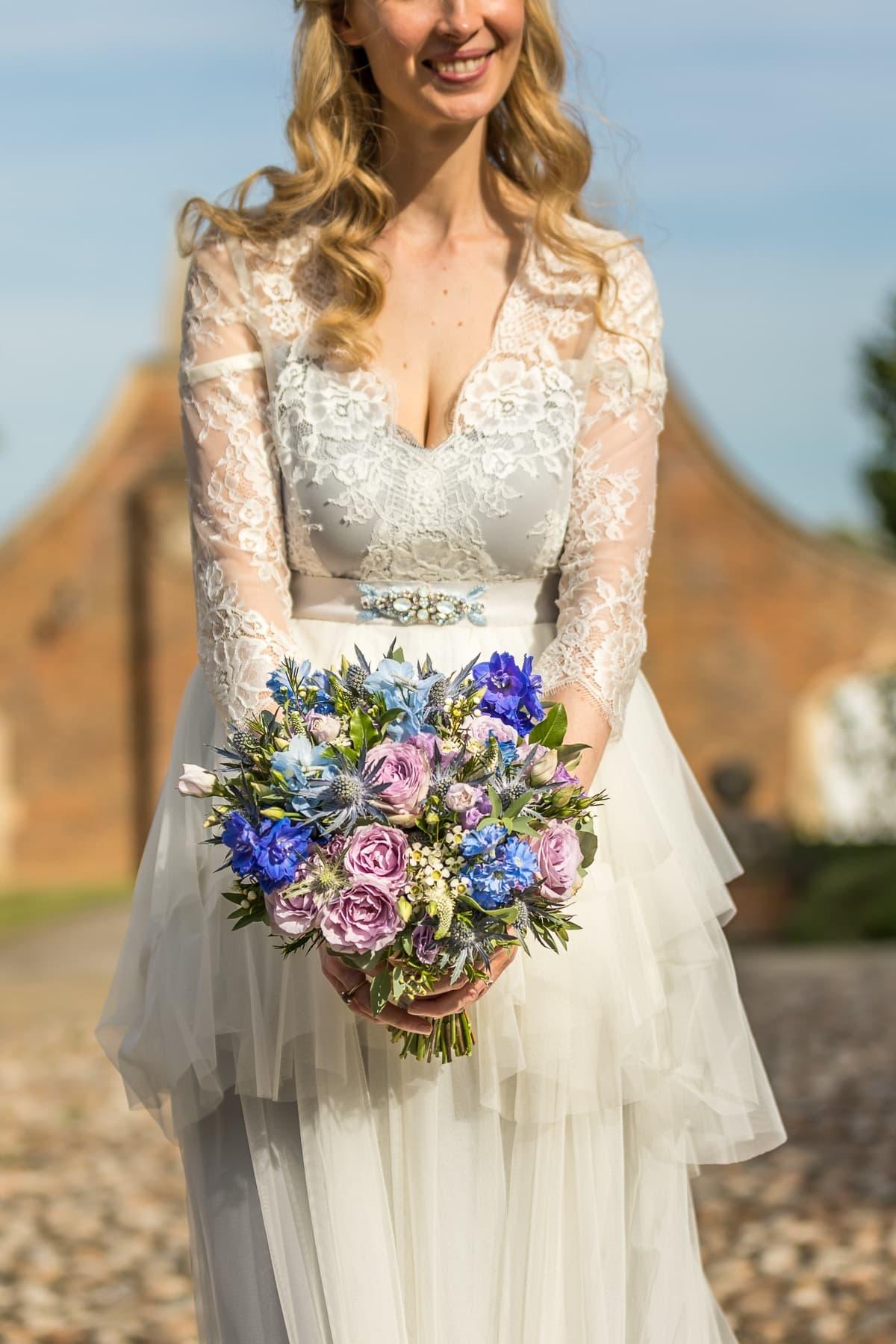 Bride and bouquet at Madingley Hall
