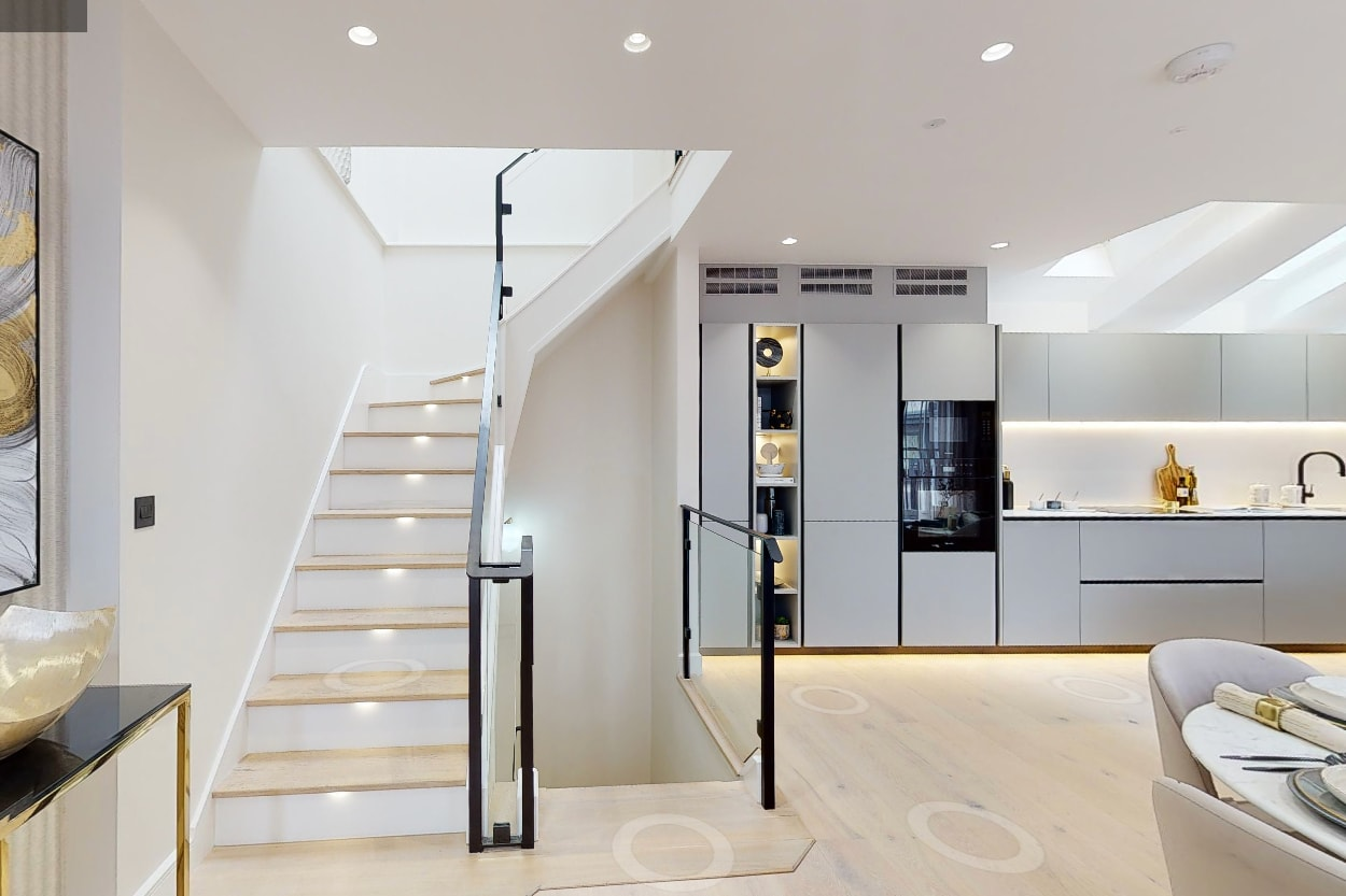 Chelsea luxury flat kitchen & stairs area with air conditioning fully enclosed with vents above units Mitsubishi Electric M Series