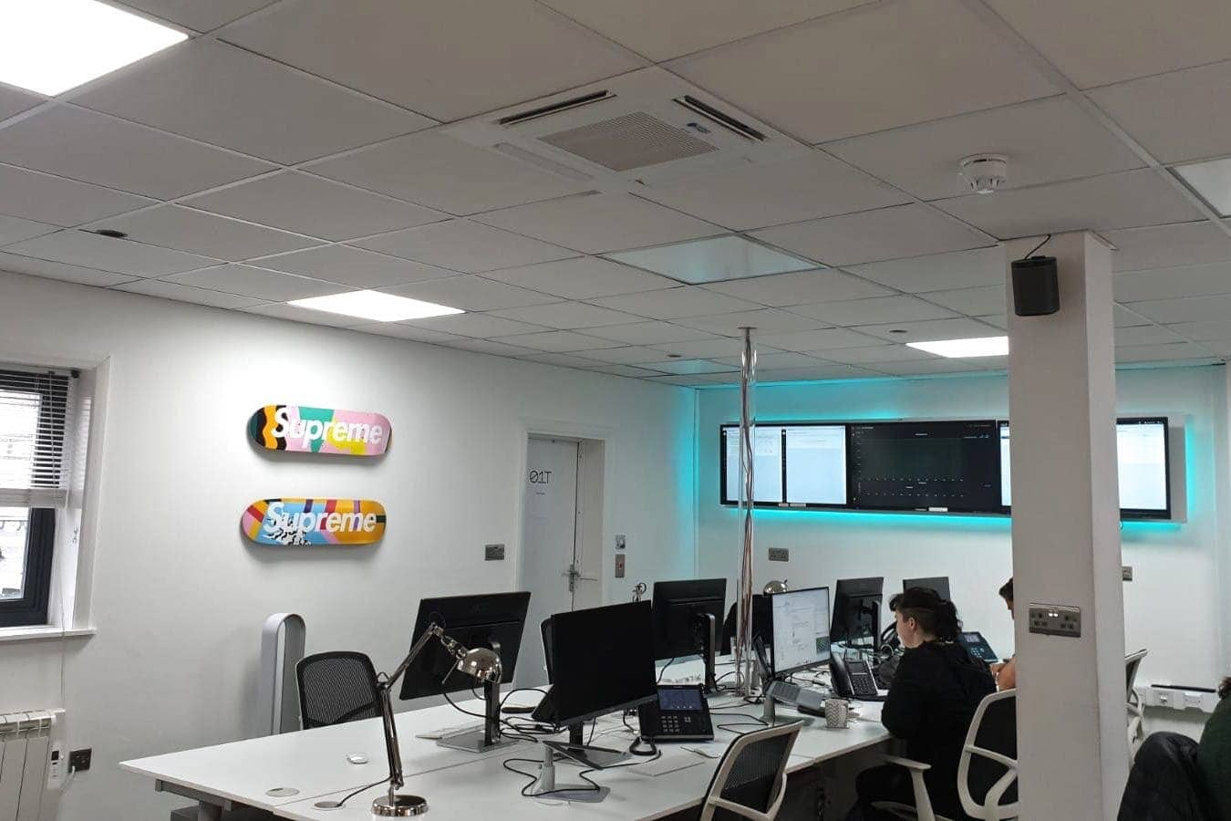 White 4 way ceiling cassette commercial air conditioning in Brighton offices in computer and desk area fitted by SubCool FM