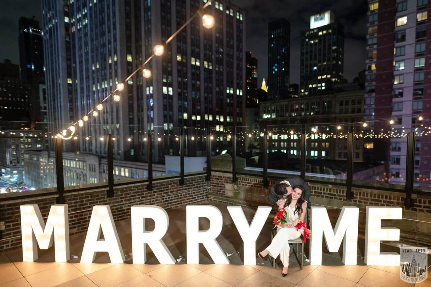 Photo 7 Gigantic Marry Me Letters Rooftop Proposal | VladLeto