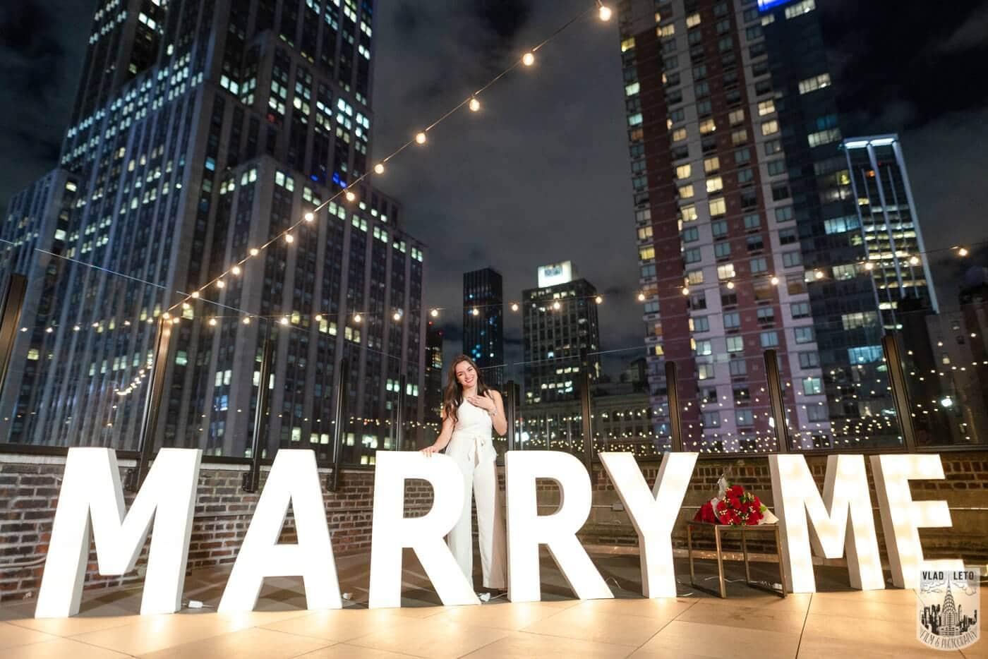Photo 4 Gigantic Marry Me Letters Rooftop Proposal | VladLeto
