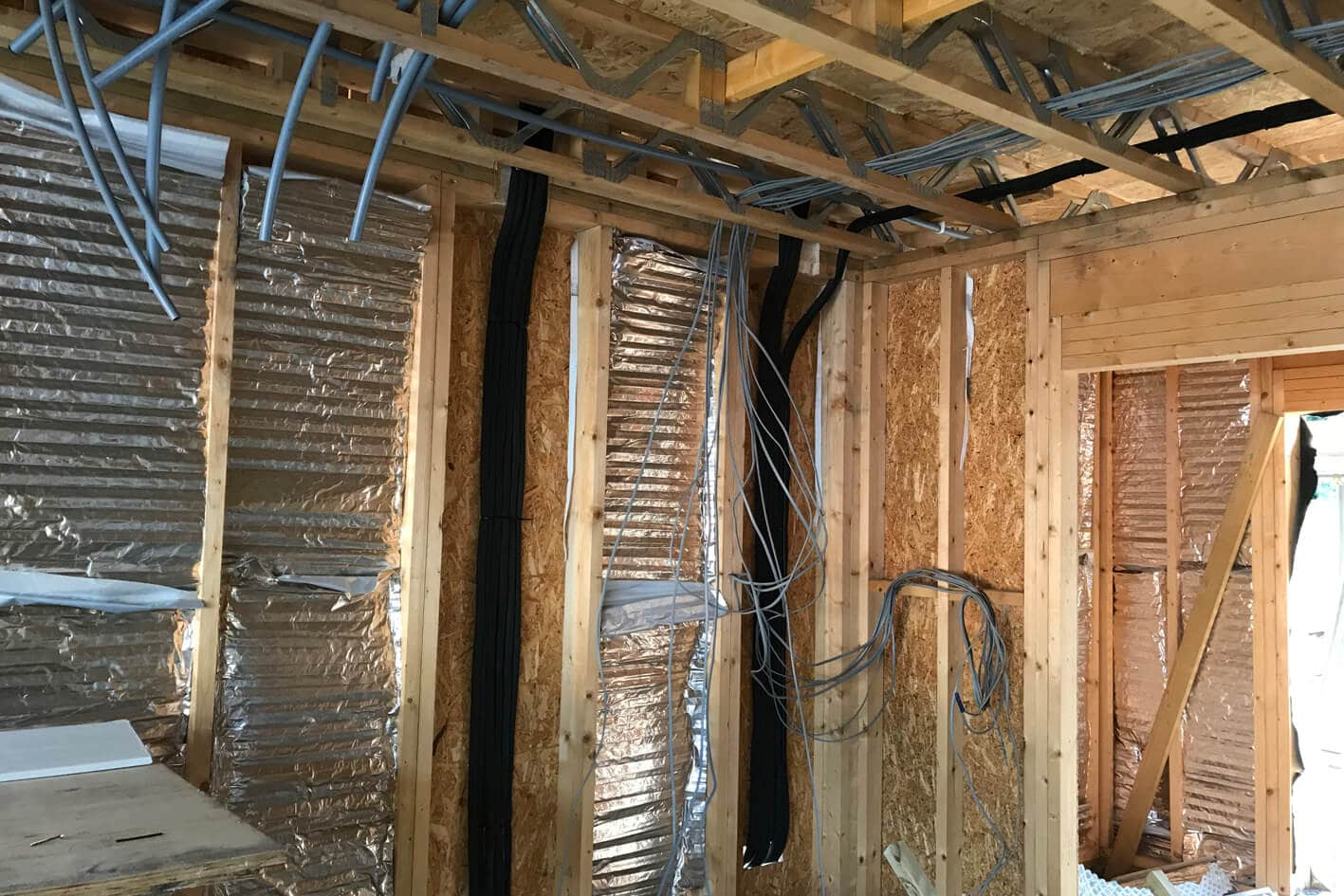 Scandia Hus new build in progress, wall shell with wires before MVHR system fitted by SubCool FM