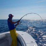 Fisher Reeling in a Tuna