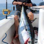 Man Holding Huge Bluefin Tuna
