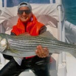 """Good morning Douglas, I would like to confirm your half-day striped bass fishing trip for your group of up to 4 passengers aboard our 33' Invincible boat with Captain Bobby scheduled for tomorrow, July 4th departing at 5:00am. Please arrive 15 minutes before your departure time. PAYMENT The balance due of $593.47 is payable by your credit card ending in 2162 or directly at the boat by cash or check. Please advise on your preferred payment method. Checks made payable to: Reel Deal. Please note it is also customary for the Captain to receive a 15-20% gratuity at your discretion. DEPARTURE LOCATION Based on recent fishing conditions, your trip will depart from Pamet Harbor, Truro. See the first departure listed at: www.fishreeldeal.com/departures. GPS address: 82 DEPOT ROAD, TRURO, MA 02666. PARKING Please arrive in one vehicle as there is limited parking available at the harbor. See the attached map for our private parking area adjacent to the main parking lot. Please use the facilities if you would like at the top of the boat ramp, then proceed to the end of the dock where our boat will pick up your group. REGULATIONS The recreational striped bass regulations for Massachusetts are 1 fish per person with a 28""""-35"""" slot size. YOUTH LIFE VESTS Please let me know if anyone in your group is under the age of 12, so that we have the proper count of youth life vests available on board. WEATHER Tomorrow's forecast is a 50% chance of morning showers with a moderate North wind. The high is 65. Please be sure to dress warmly as it is always cooler on the water and also let me know if anyone in your group would like to borrow rain gear. Please confirm receipt of this message as well as your preferred payment method. See you tomorrow! Regards, Elena"""