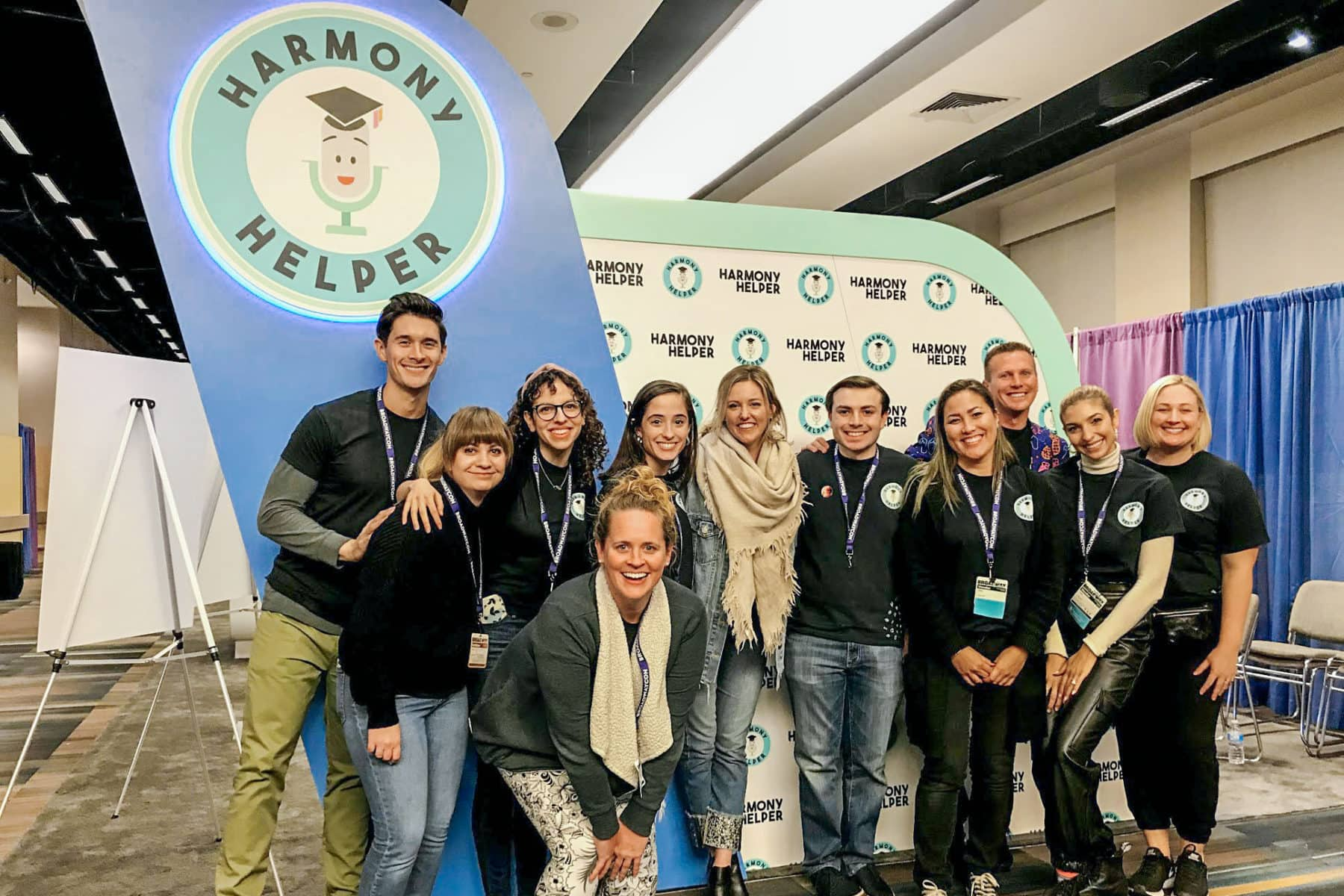 The Harmony Helper team poses in front of their booth at BroadwayCon 2020