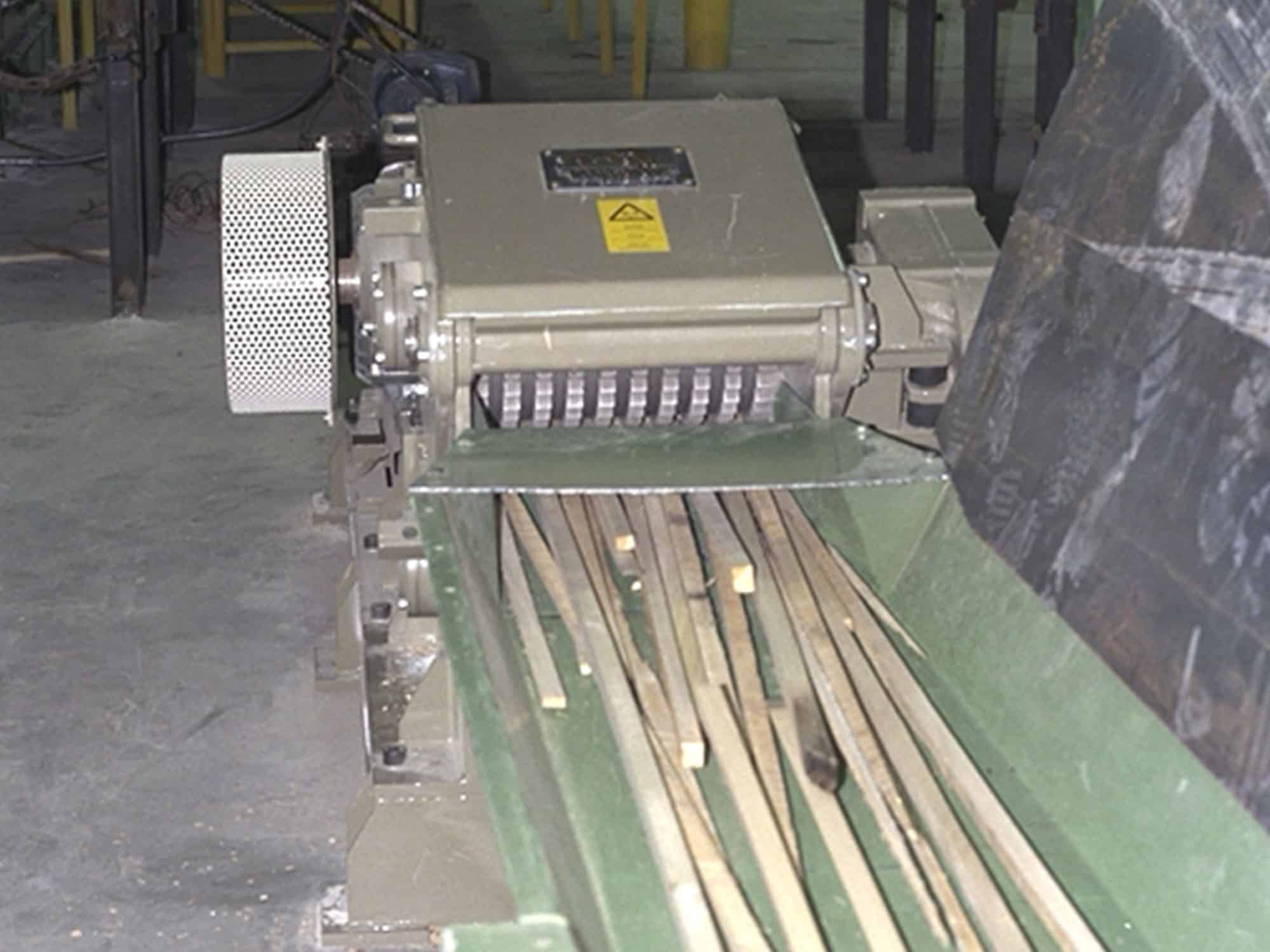 two Scanhugger HT 45-45-2 at factory as end of production line off-cut wood shredder with vibration conveyor feeding wood sticks