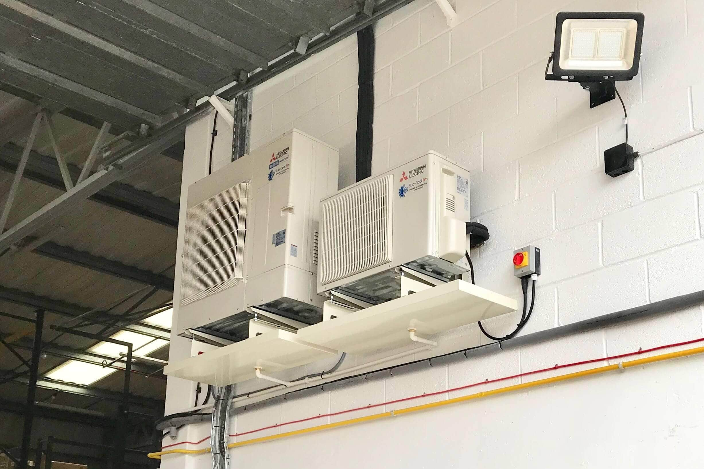 Large commercial air conditioning units installed in a warehouse