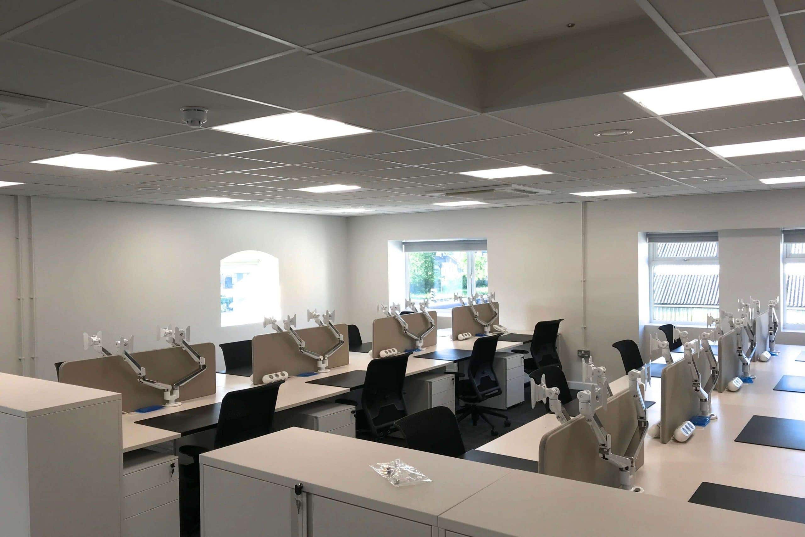 Norwood junction large commercial air conditioning solution by SubCool FM white ceiling cassette in multi-desk office or hot desk area