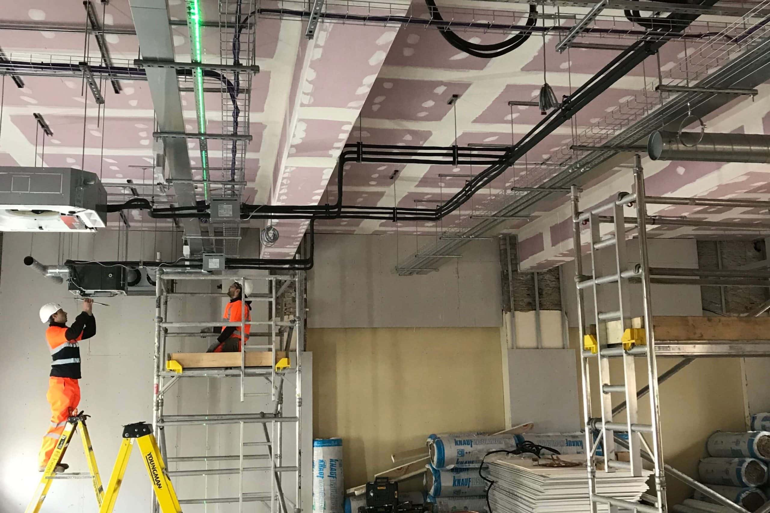 Norwood junction large commercial air conditioning solution by SubCool FM with engineers fitting hanging ceiling units