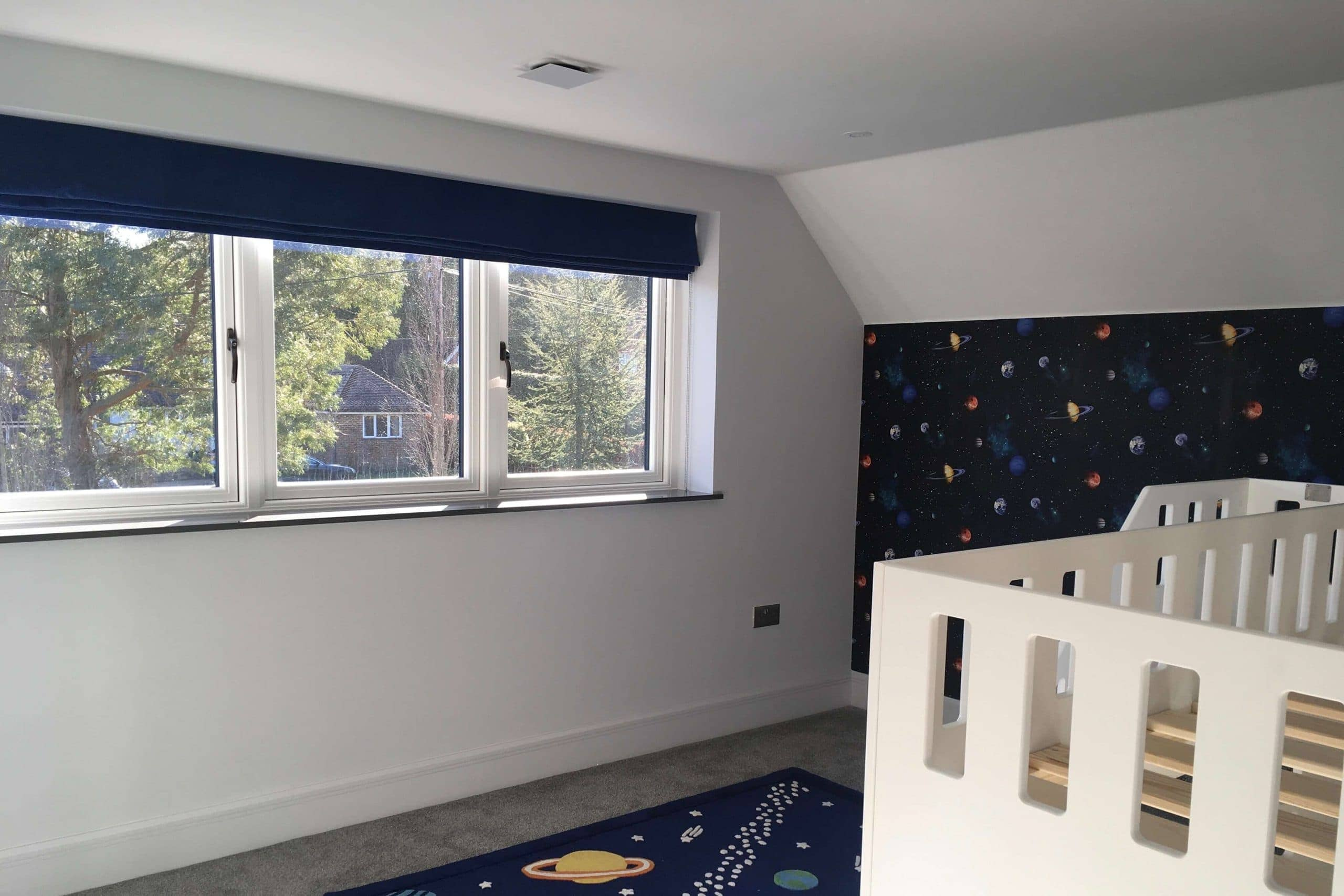 Air conditioning and MVHR system by SubCool FM in boys bedroom - fresh air and climate control through vent behind square on ceiling