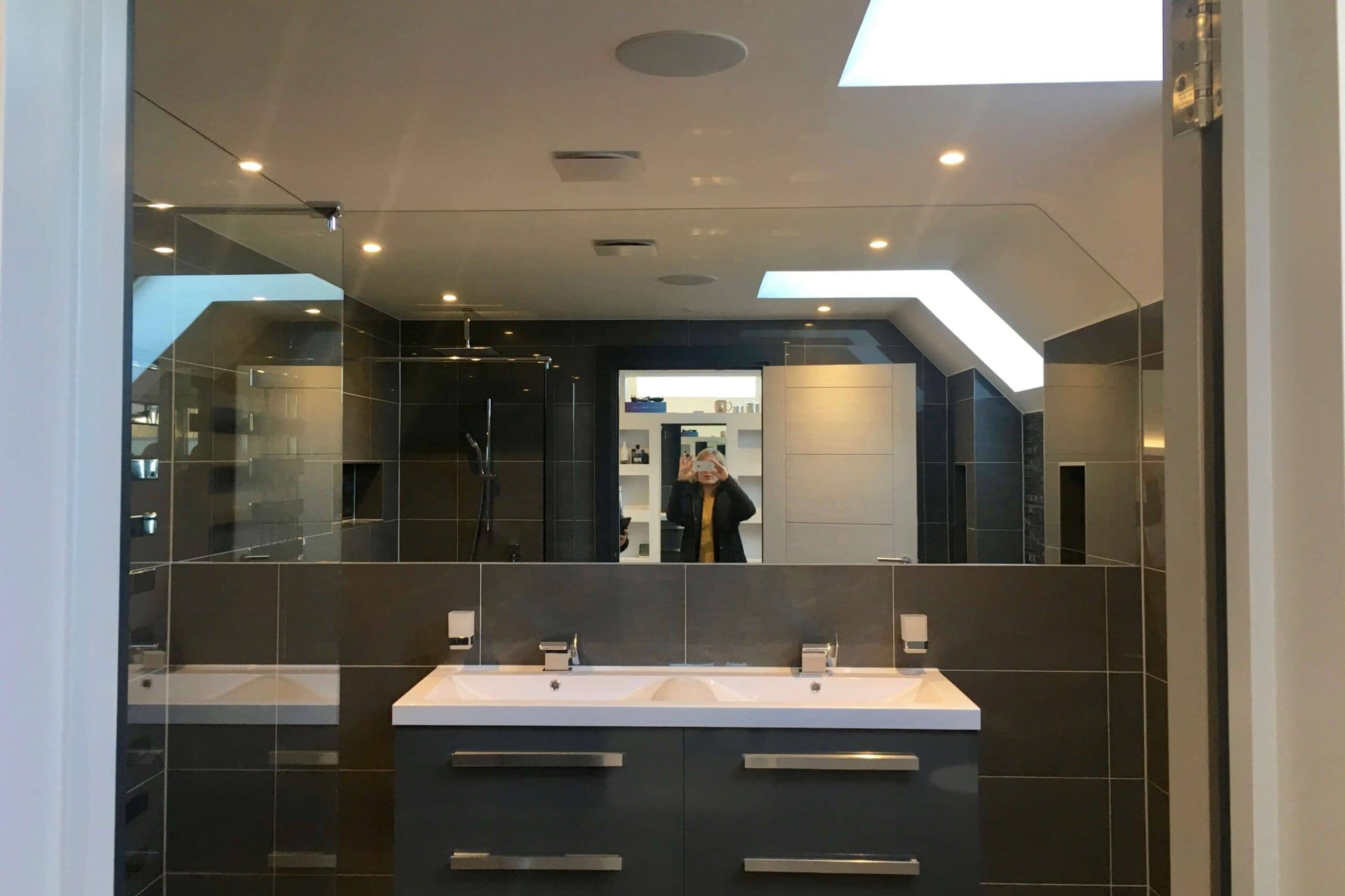 Bathroom in Scandia Hus new build with ceiling squares hidding MVHR system by SubCool FM