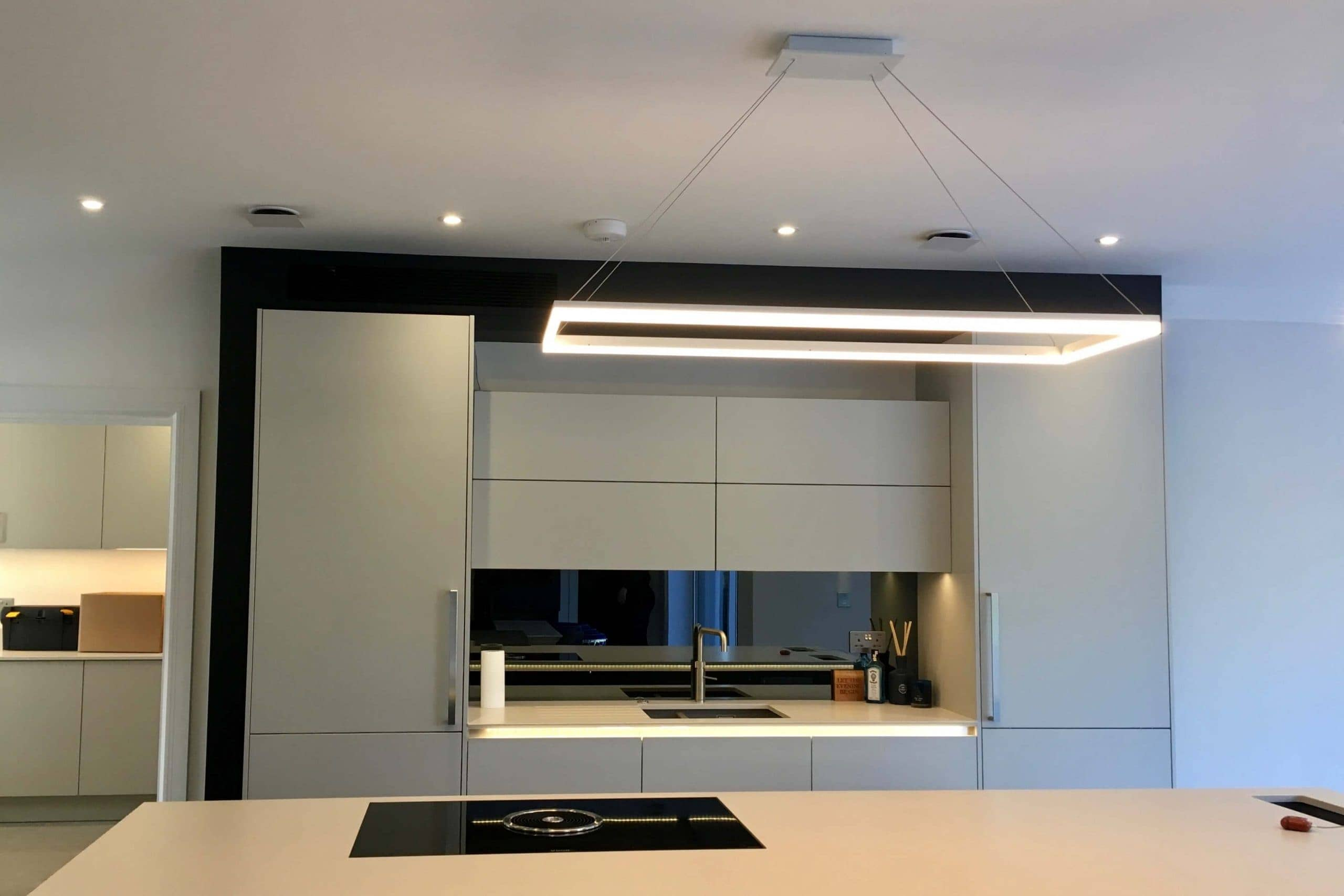 Scandia Hus new build kitchen with invisible Mitsubishi air con grill and MVHR system by SubCool FM hidden door to chill room shut