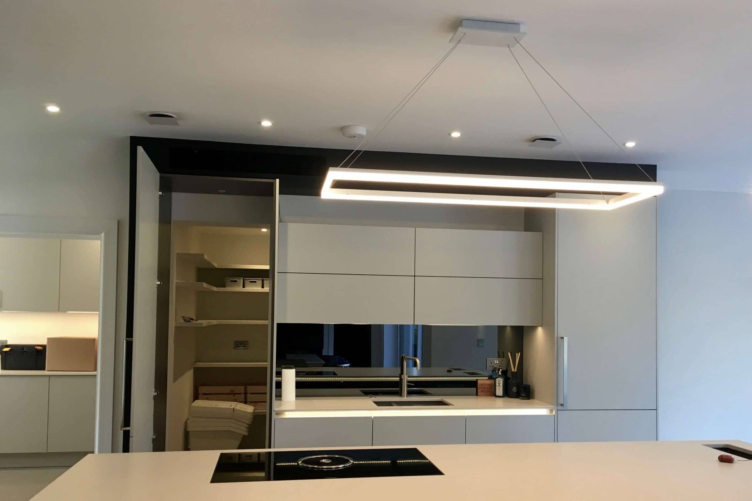 Scandia Hus new build kitchen with invisible Mitsubishi air con grill and MVHR system by SubCool FM hidden door to chill room open
