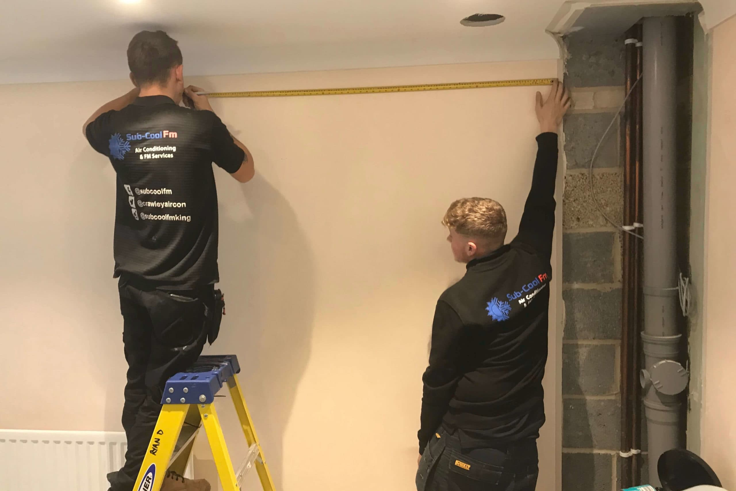 2 SuCoolFm engineers measuring for air conditioning installation