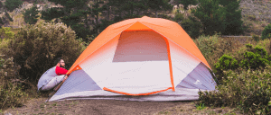 A man setting up and instant tent