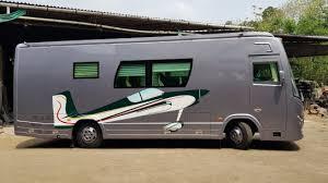 picture showing a tourist bus/caravan