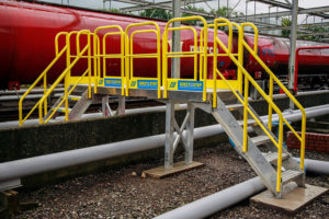 Metal Pipe Crossover Stairs With Handrails