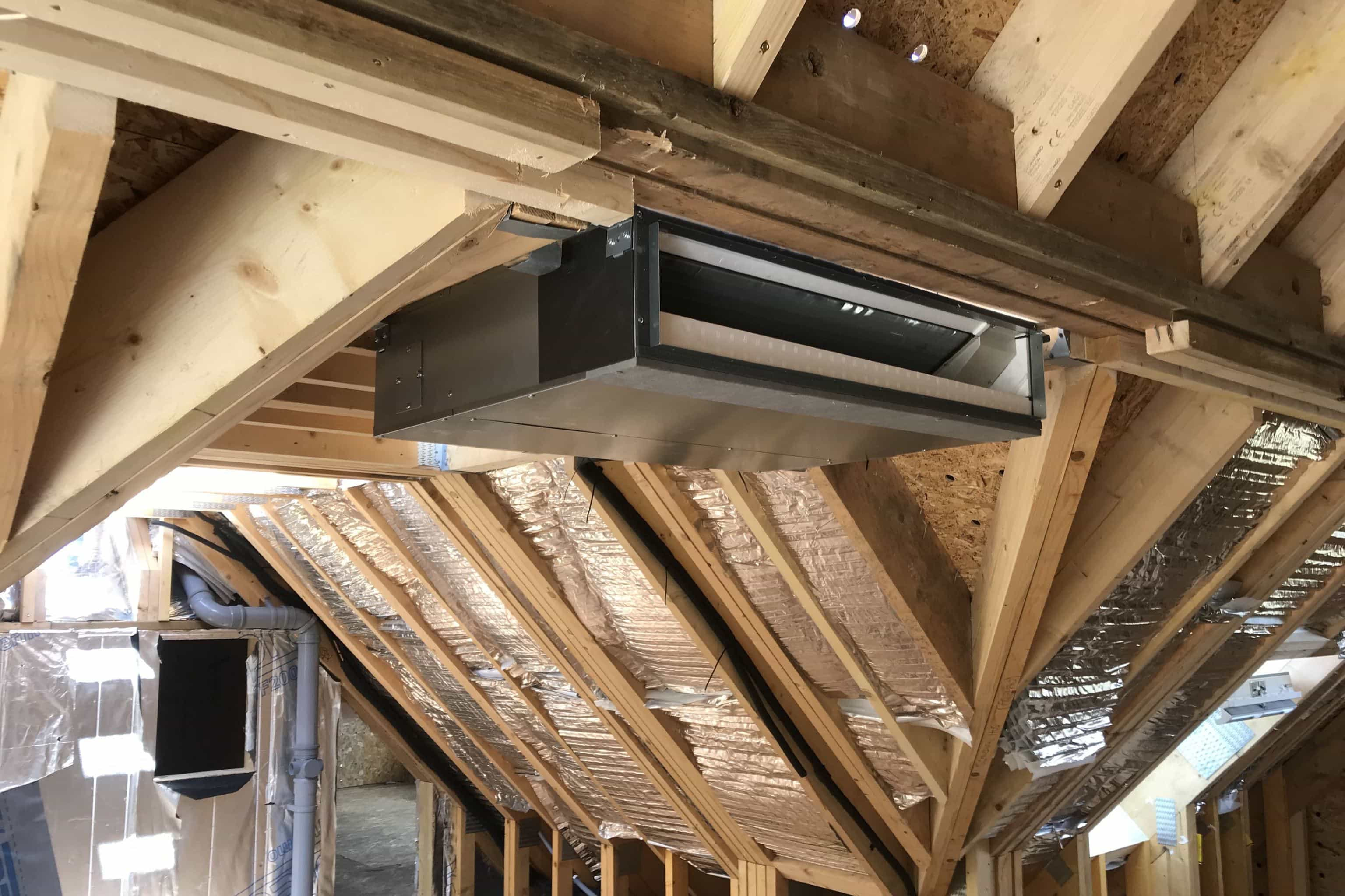 Ducted ceiling domestic air conditioning unit in new build in Ringwood, Crawley Down still in building stages