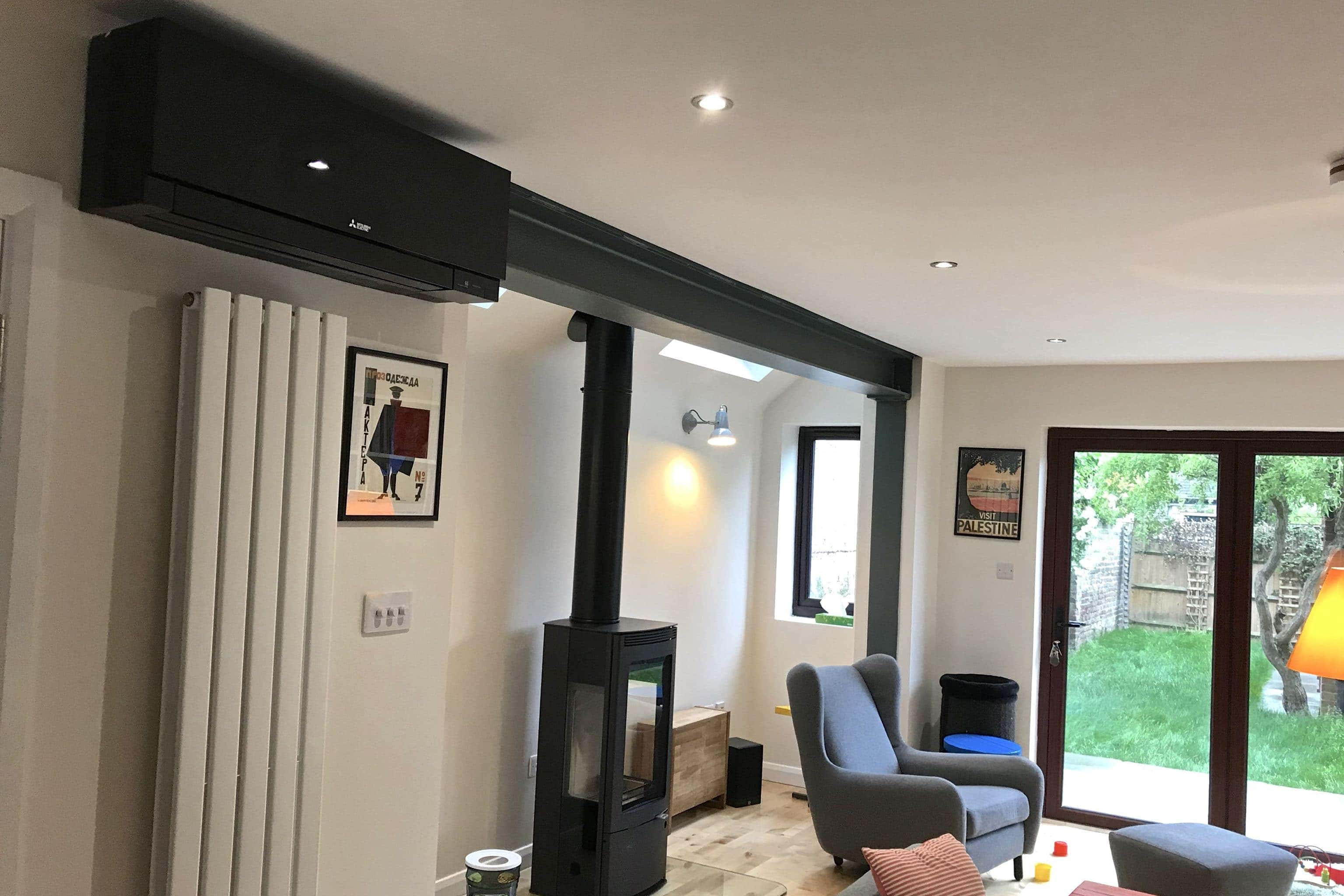 black wall mounted Mitsubishi Electric domestic air conditioning unit in living room