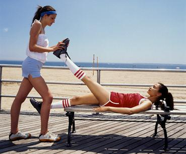 Two Girls Using PNF Stretching