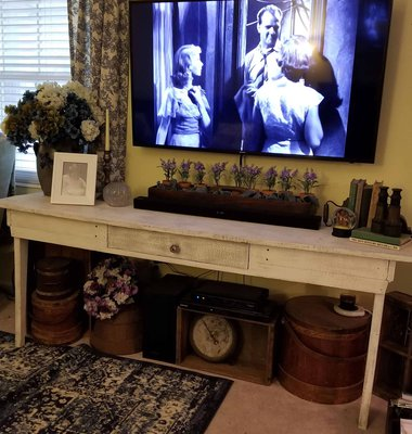 Long white table under a wall hung tv