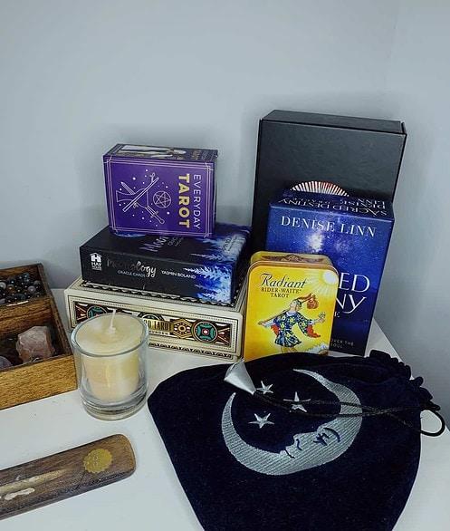 collection of tarot decks on altar