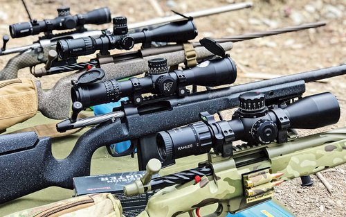 Four scopes mounted to rifles