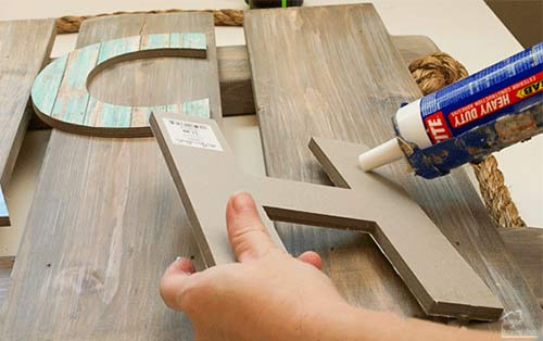 glueing letters to wood pallet display