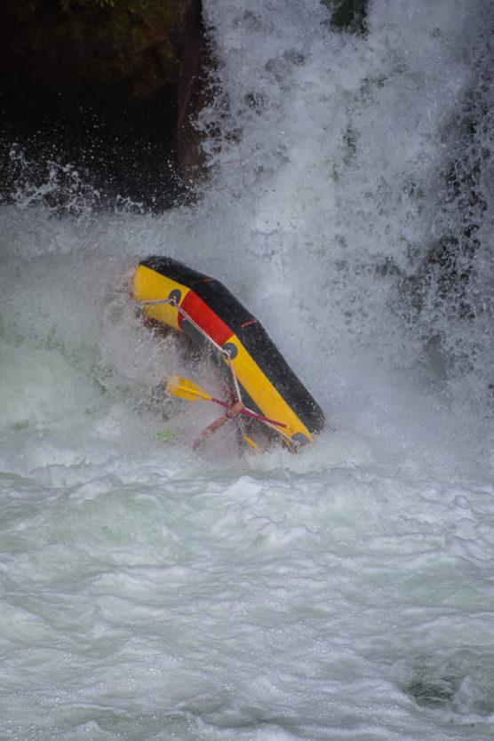 flipping over tutea falls on new zealand rafting trip with kaituna cascades