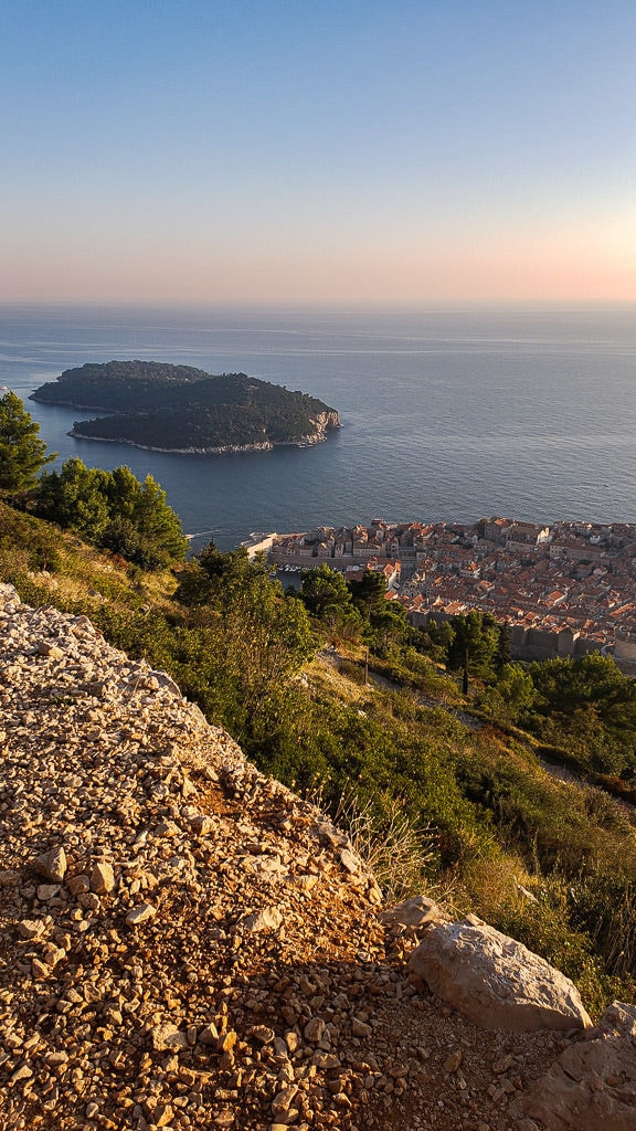 View of Lokrum Island and Old Town Dubrovnik while hiking up Mount Srd
