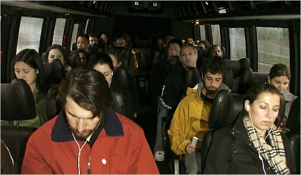 Company staff in bus